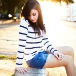 Girl sitting on the curb